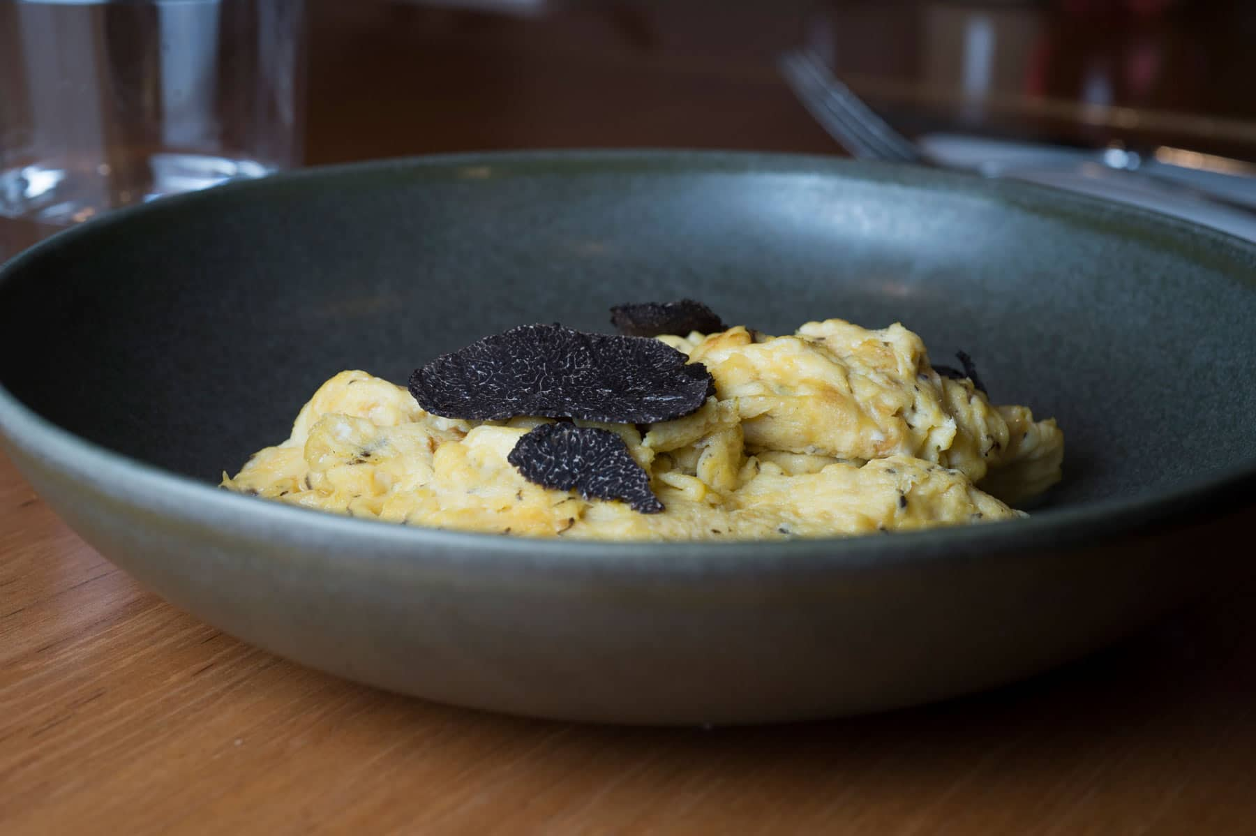 Shaved truffle over truffle-infused scrambled eggs. Simple and sublime!